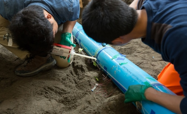 A glue gun was used to attach the sensors to the plastic pipe. Photo by Patrick Shanahan, Cornell University.