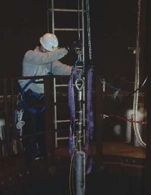 A trial anode string is lowered into the monopile's contained water. Photo courtesy of Alex Delwiche.