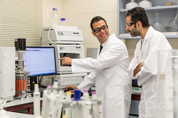 Researchers Aydin Berenjian and Mostafa Seifan study testing results in the lab. Photo courtesy of The University of Waikato.
