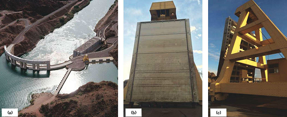 Parker Dam (a) has four penstock gates on the west side of the main river (shown on the right). A hoist crane is used to access the upstream (b) and downstream (c) sides of the penstock gates.
