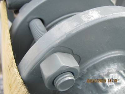 Figure 2: This poorly feathered three-coat system following coating repairs from bolt tightening will lead to lifting, creep, and rusty flanges.