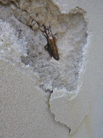 Spalling concrete on a hotel wall shows corroded reinforcing rods. Photo courtesy of ACA.